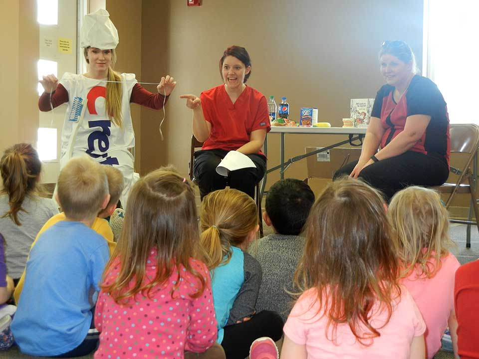teaching children about brushing teeth and flossing